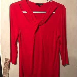 Red blouse with crisscross front.